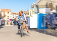 Senior couple on bike Stock Image
