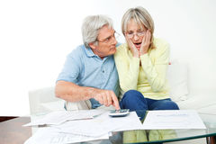 Senior couple with bills Stock Photography