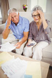 Senior couple with bills looking worried Royalty Free Stock Images