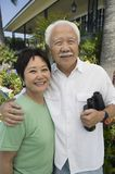 Senior couple with binoculars outdoors (portrait) Stock Photos