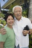 Senior couple with binoculars outdoors (portrait) Stock Photos