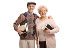 Senior couple with books royalty free stock photography