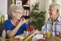 Senior couple during breakfast Stock Photos