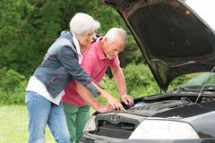 Senior couple at broken car Stock Photography