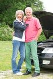 Senior couple at broken car Stock Photo