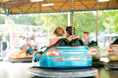 Senior couple in the bumper car at the fun fair Stock Images