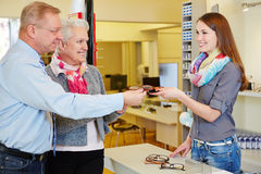 Senior couple buying glasses Stock Photography