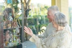 Senior couple buying Royalty Free Stock Image