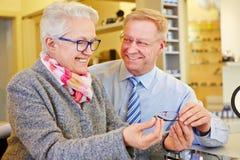 Senior couple buying new glasses Royalty Free Stock Photo