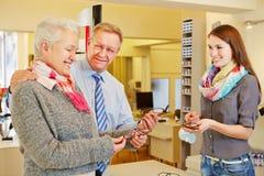 Senior couple buying new glasses at Stock Photo