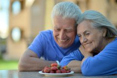 Senior couple in cafe with strawberries Royalty Free Stock Images