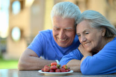 Senior couple in cafe with strawberries Stock Images