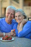 Senior couple in cafe with strawberries Stock Image