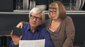 Senior couple calculate their bills Stock Photos