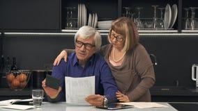Senior couple calculate their bills Stock Photo