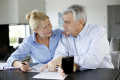 Senior couple calculating budget Stock Photos