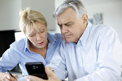 Senior couple calculating budget Royalty Free Stock Images
