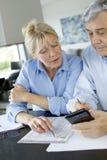 Senior couple calculating budget Royalty Free Stock Photos