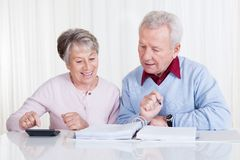Senior couple calculating budget Stock Photography