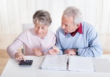 Senior couple calculating budget Royalty Free Stock Photo
