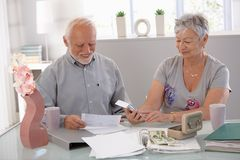 Senior couple calculating family budget Stock Photography