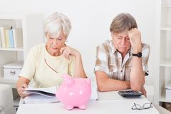 Senior couple calculating finance Stock Photo