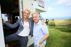 Senior couple with camping car Royalty Free Stock Photos