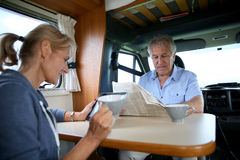 Senior couple in camping car Stock Photo