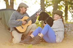 Senior couple camping and enjoying music Royalty Free Stock Photography
