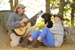 Senior couple camping and enjoying music Stock Photography