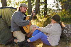 Senior couple camping and enjoying music Royalty Free Stock Photo