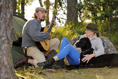 Senior couple camping and enjoying music Stock Photography