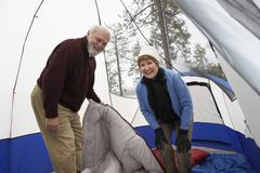 Senior Couple Camping In Tent Royalty Free Stock Images
