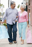 Senior Couple Carrying Shopping Bags Royalty Free Stock Photography