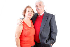 Senior couple celebrate Valentines Day together. Standing arm in arm in a romantic embrace signifying the lifelong love - together forever concept, upper body Royalty Free Stock Images