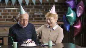 Senior couple celebrating birthday at the table stock video