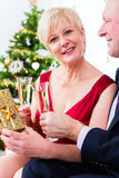 Senior couple celebrating Christmas with champagne Stock Photography