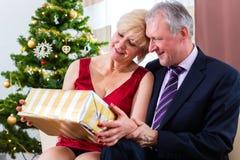 Senior couple celebrating Christmas eve Royalty Free Stock Photography