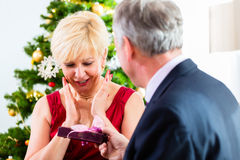 Senior couple celebrating Christmas with presents Stock Image