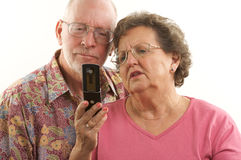 Senior Couple & Cell Phone Stock Image