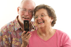 Senior Couple and Cell Phone Royalty Free Stock Images