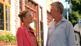 Senior couple chatting in the city on a sunny day stock video