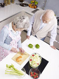 Senior couple chatting in kitchen Royalty Free Stock Image