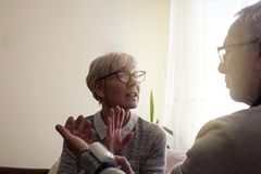 Elderly woman worried about her husbands high blood pressure royalty free stock images