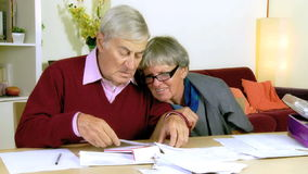 Senior couple checking documents and bills stock video