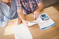 Senior couple checking their bills Royalty Free Stock Photos