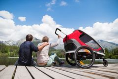 Senior couple with jogging stroller, summer day. Royalty Free Stock Image