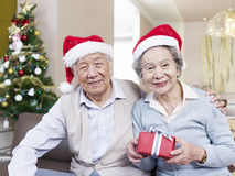 Senior couple with christmas hats Royalty Free Stock Image
