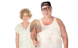 Senior couple in classic pose. Senior couple with shovel in an American Gothic pose Stock Photos