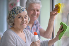 Senior couple cleaning royalty free stock photo